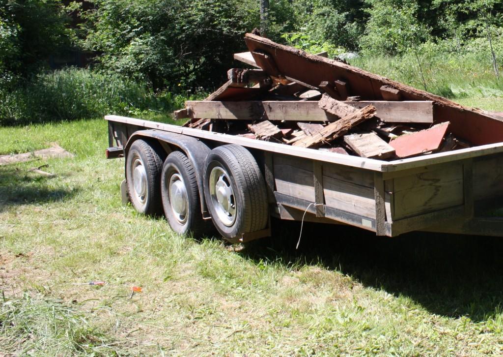 Demolished deck rubble piled in borrowed trailer, July 2, 2013, photo by Karin Blaski