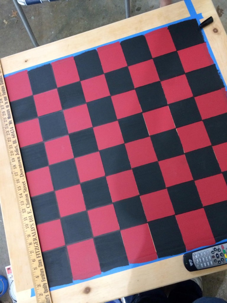 When the black squares are done, remove the tape and prepare to paint the border.