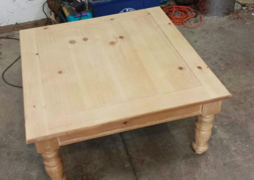 The square table, once covered with child graffiti, now sanded to pristine perfection.