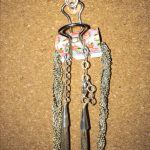 Hanging necklaces with binder clip on cork board