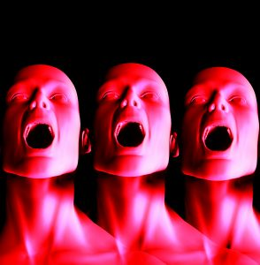 Three faces screaming in agony