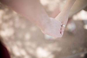 holding hands in love outside